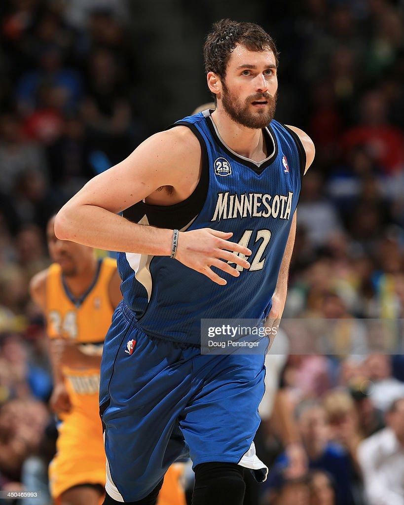 Kevin Love #42 of the Minnesota Timberwolves heads upcourt against the Denver Nuggets at Pepsi Center on November 15, 2013 in Denver, Colorado. The Nuggets defeated the Timberwolves 117-113.
