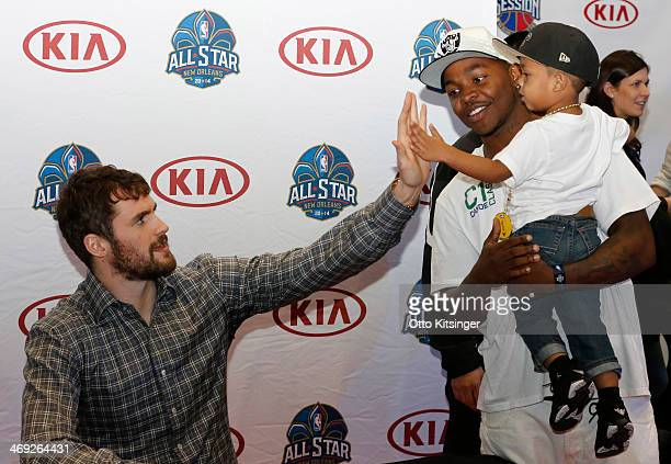 Kevin Love of the Minnesota Timberwolves high fives a young fan at the Kia MVP Court during the 2014 NBA AllStar Jam Session at the Ernest N Morial...