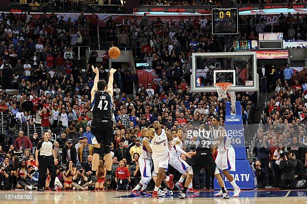 Kevin Love of the Minnesota Timberwolves hits the winning shot against the Los Angeles Clippers at Staples Center on January 20 2012 in Los Angeles...