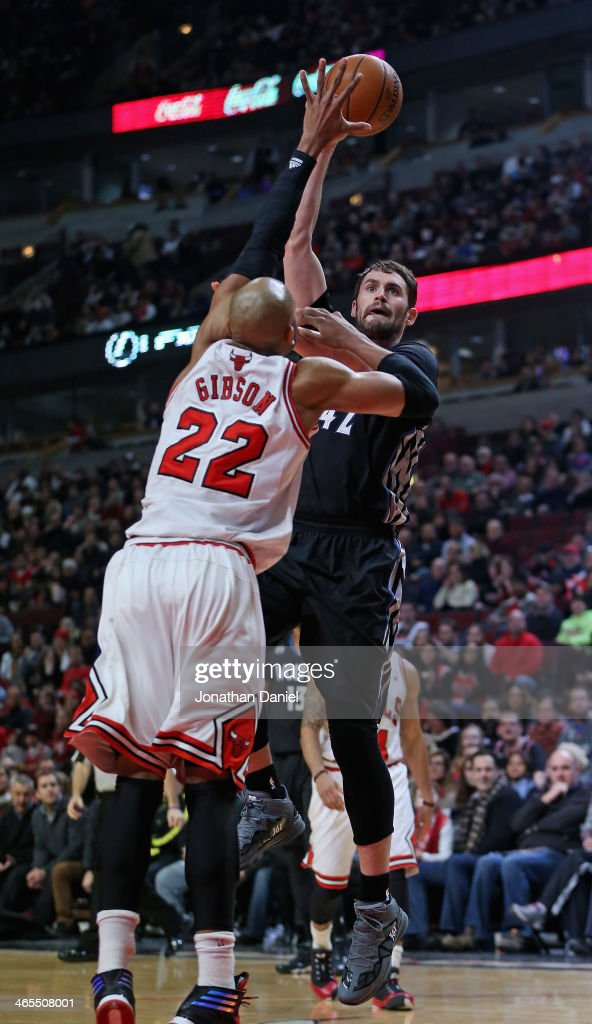 Kevin Love #42 of the Minnesota Timberwolves puts up a shot over Taj Gibson #22 of the Chicago Bulls at the United Center on January 27, 2014 in Chicago, Illinois.