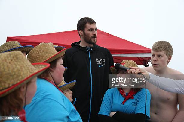 Kevin Love of the Minnesota Timberwolves recites the Athletes Pledge with members of Minnesota Special Olympics Team Western Wings prior to jumping...