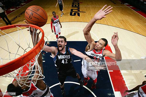 Kevin Love of the Minnesota Timberwolves shoots against JaVale McGee of the Washington Wizards during the game at the Verizon Center on January 8,...