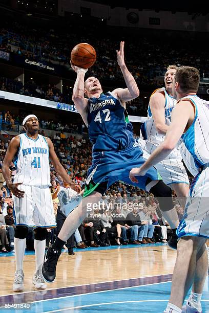 Kevin Love of the Minnesota Timberwolves shoots over James Posey Sean Marks and Ryan Bowen of the New Orleans Hornets on March 18 2009 at the New...