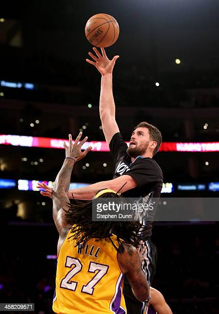 Kevin Love of the Minnesota Timberwolves shoots over Jordan Hill of the Los Angeles Lakers at Staples Center on December 20, 2013 in Los Angeles,...
