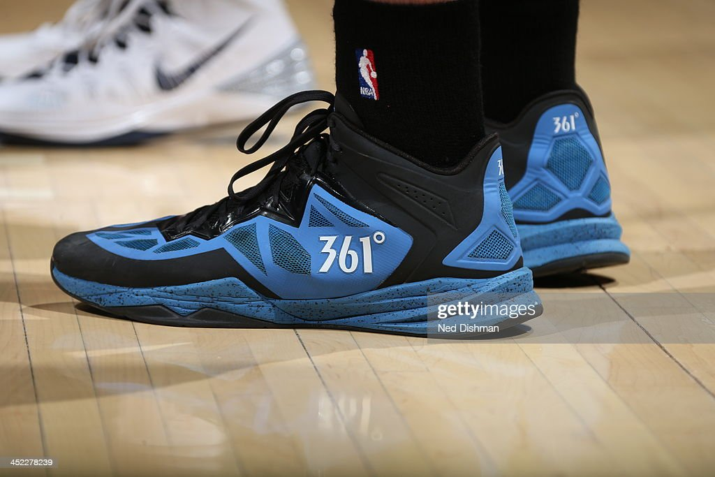 Kevin Love #42 of the Minnesota Timberwolves show cases his sneakers against the Washington Wizards during the game at the Verizon Center on November 19, 2013 in Washington, DC.