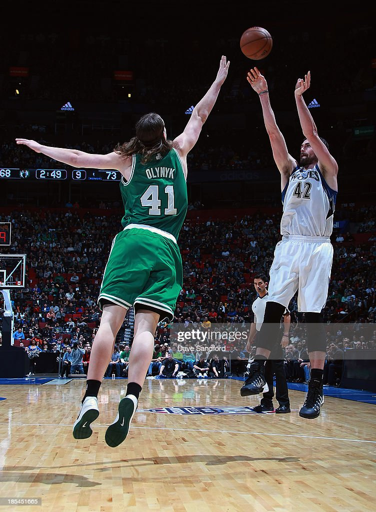 Kevin Love #42 of the Minnesota Timberwolves takes a jump shot over Kelly Olynyk #41 of the Boston Celtics during the NBA pre-season game at the Bell Centre on October 20, 2013 in Montreal, Quebec, Canada.