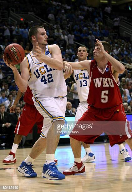 Kevin Love of the UCLA Bruins controls the ball while Ty Rogers of the Western Kentucky Hilltoppers defends in the second half of the West Regional...