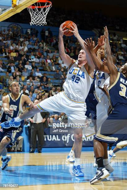 Kevin Love of the UCLA Bruins pulls down a rebound against the George Washington Colonials during the first half at Pauley Pavilion on November 28,...