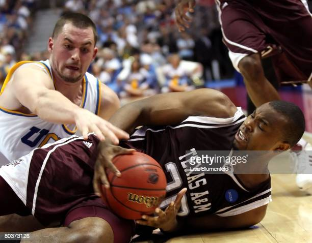 Kevin Love of the UCLA Bruins tries to take possession of the ball from Joseph Jones of the Texas AM Aggies during the West Region second round of...