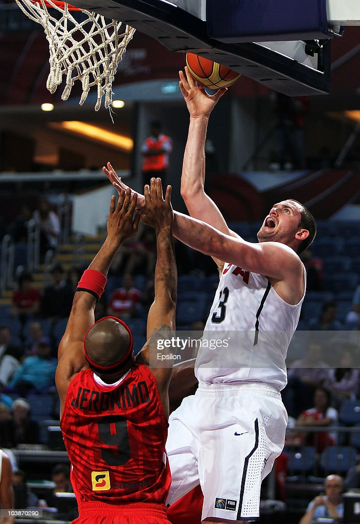 Kevin Love (R) of USA battles for the ball with Vladimir Jeronimo (L) of Angola at the 2010 World Championships of Basketball during the game between USA vs Angola on September 6, 2010 in Istanbul, Turkey.