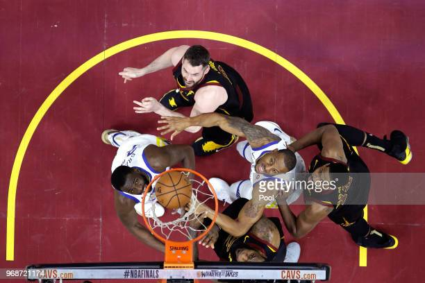 Kevin Love Tristan Thompson and LeBron James of the Cleveland Cavaliers fight for a rebound with Draymond Green and Andre Iguodala of the Golden...