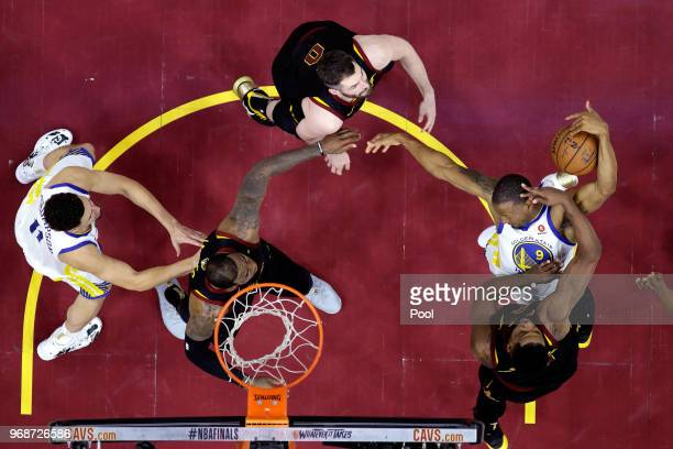 Kevin Love Tristan Thompson and LeBron James of the Cleveland Cavaliers fight for a rebound with Klay Thompson and Andre Iguodala of the Golden State...