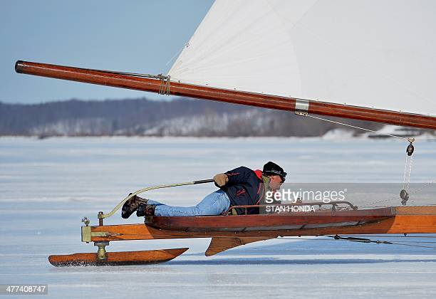 Kevin Lowrence steers the ice boat Jack Frost as he sails on a frozen Hudson River March 7 2014 in Barrytown New York These historic 'ice yachts'...