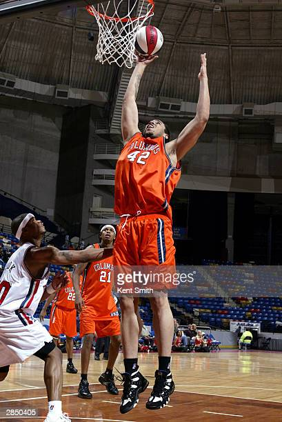 Kevin Lyde of the Columbus Riverdragons rebounds against the Fayetteville Patriots during the game at Crown Coliseum on December 12, 2003 in...