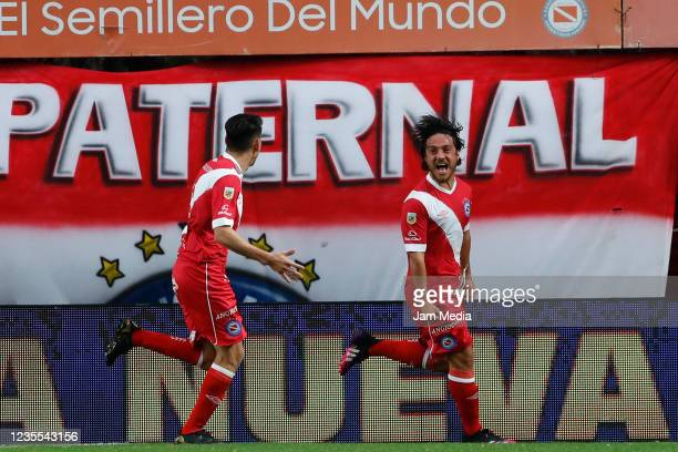 Kevin MacAllister of Argentinos Juniors celebrates with teammate Lucas Villalba after scoring the second goal of his team during a match between...