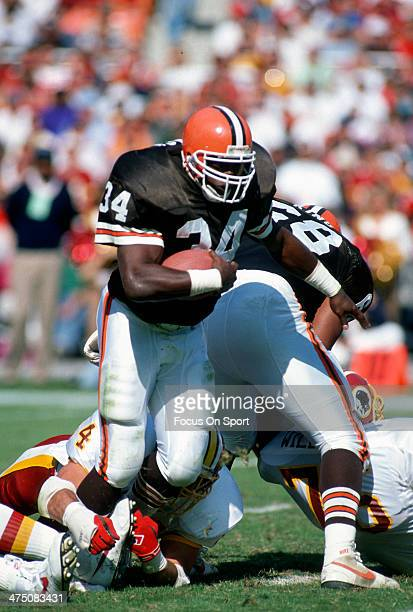 Kevin Mack of the Cleveland Browns carries the ball against the Washington Redskins during an NFL Football game October 13 1991 at RFK Stadium in...