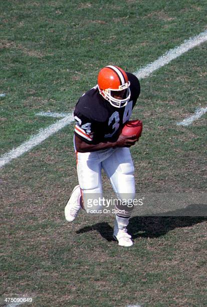 Kevin Mack of the Cleveland Browns carries the ball against the Miami Dolphins during an NFL Football game circa 1990 at Cleveland Municipal Stadium...