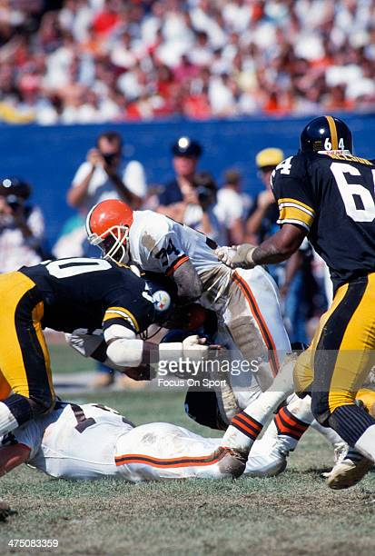 Kevin Mack of the Cleveland Browns gets hit by David Little of the Pittsburgh Steelers during an NFL Football game September 20 1987 at Cleveland...