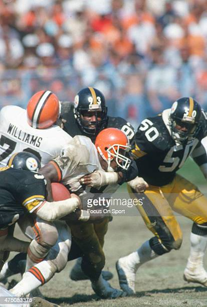 Kevin Mack of the Cleveland Browns gets tackled by Keith Willis of the Pittsburgh Steelers during an NFL Football game September 20 1987 at Cleveland...
