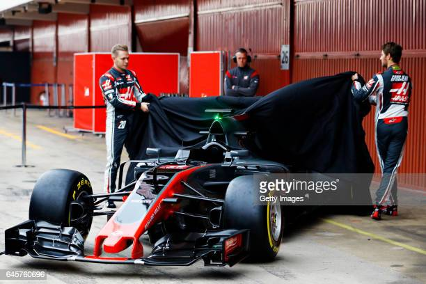 Kevin Magnussen of Denmark and Haas F1 and Romain Grosjean of France and Haas F1 at the roll out of the HaasFerrari VF17 in the Pitlane during day...