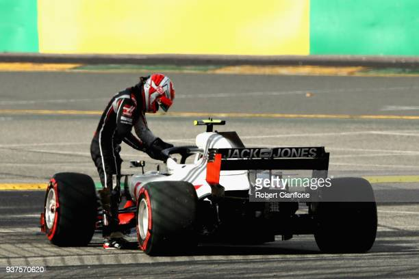 Kevin Magnussen of Denmark and Haas F1 climbs from his car after retiring during the Australian Formula One Grand Prix at Albert Park on March 25,...
