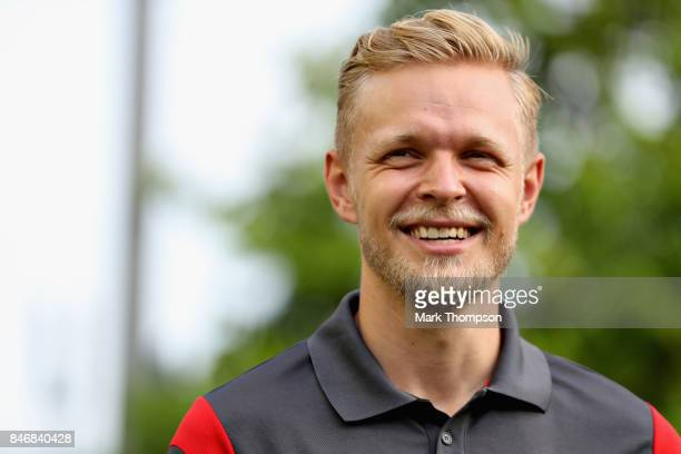 Kevin Magnussen of Denmark and Haas F1 looks on in the Paddock during previews ahead of the Formula One Grand Prix of Singapore at Marina Bay Street...