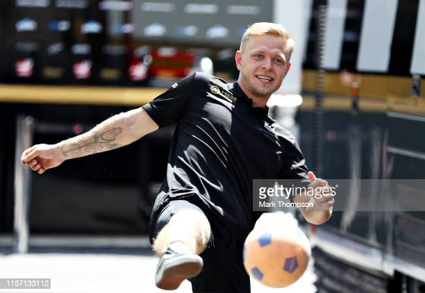 Kevin Magnussen of Denmark and Haas F1 plays football in the Paddock during previews ahead of the F1 Grand Prix of France at Circuit Paul Ricard on...