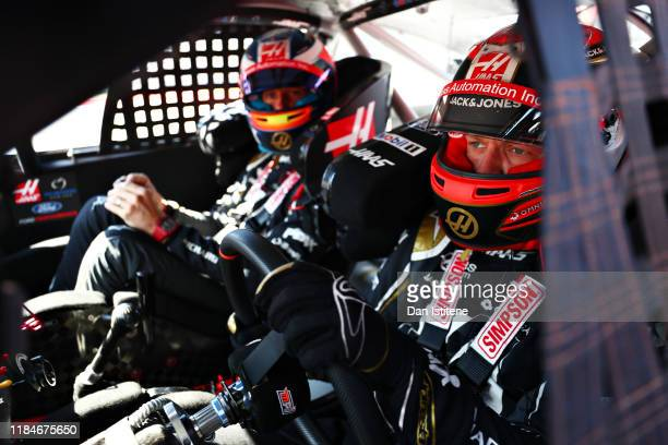 Kevin Magnussen of Denmark and Haas F1 prepares to drive the No.14 Haas Automation Ford Mustang in a demonstration run with Romain Grosjean of France...