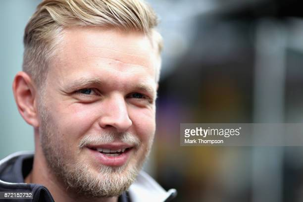 Kevin Magnussen of Denmark and Haas F1 talks in the Paddock during previews for the Formula One Grand Prix of Brazil at Autodromo Jose Carlos Pace on...