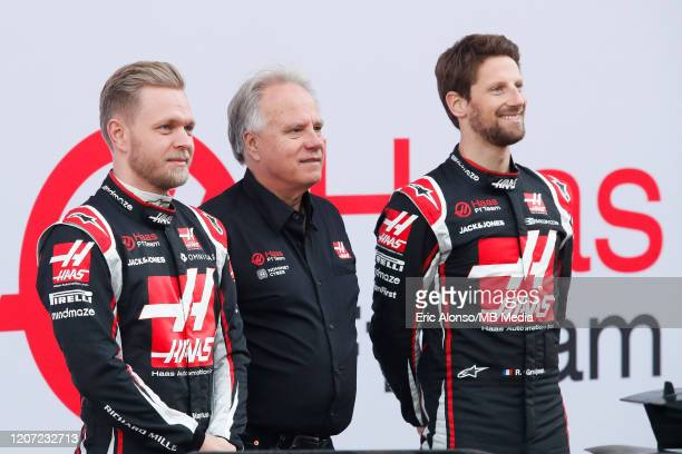 Kevin Magnussen of Denmark and Haas F1 Team , Gene Haas and Romain Grosjean of France and Haas F1 Team during day one of Formula 1 Winter Testing at...