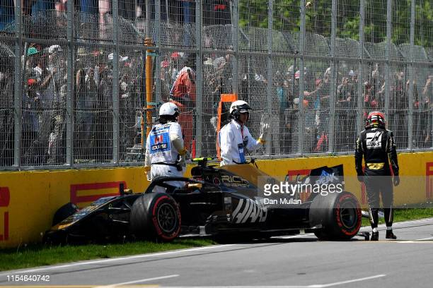 Kevin Magnussen of Denmark and Haas F1 walks from his car after crashing on track during qualifying for the F1 Grand Prix of Canada at Circuit Gilles...