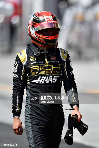 Kevin Magnussen of Denmark and Haas F1 walks in the Pitlane after crashing during qualifying for the F1 Grand Prix of Canada at Circuit Gilles...