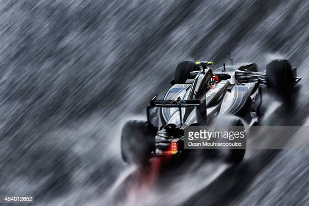 Kevin Magnussen of Denmark and McLaren drives during qualifying ahead of the Belgian Grand Prix at Circuit de Spa-Francorchamps on August 23, 2014 in...