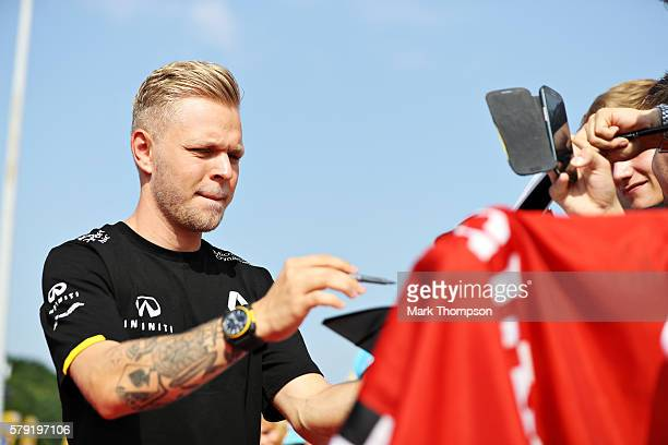 Kevin Magnussen of Denmark and Renault Sport F1 signs autographs for fans before final practice for the Formula One Grand Prix of Hungary at...