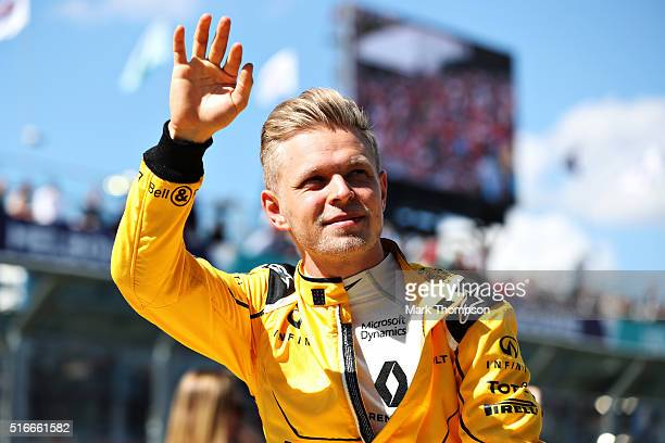 Kevin Magnussen of Denmark and Renault Sport F1 waves to the crowd on the drivers parade ahead of the Australian Formula One Grand Prix at Albert...