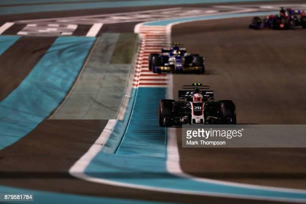 Kevin Magnussen of Denmark driving the Haas F1 Team HaasFerrari VF17 Ferrari leads Pascal Wehrlein of Germany driving the Sauber F1 Team Sauber C36...