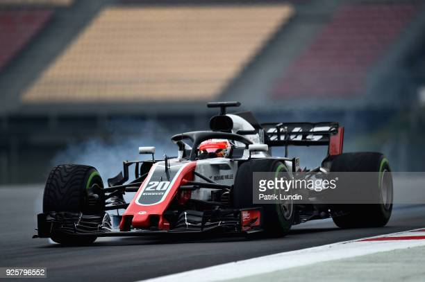 Kevin Magnussen of Denmark driving the Haas F1 Team VF18 Ferrari locks a wheel under braking during day four of F1 Winter Testing at Circuit de...