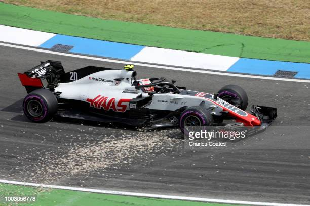 Kevin Magnussen of Denmark driving the Haas F1 Team VF18 Ferrari over gravel during qualifying for the Formula One Grand Prix of Germany at...