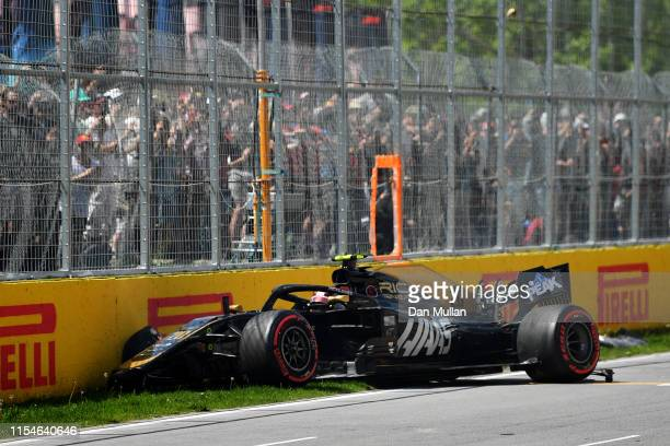 Kevin Magnussen of Denmark driving the Haas F1 Team VF19 Ferrari crashes on track during qualifying for the F1 Grand Prix of Canada at Circuit Gilles...