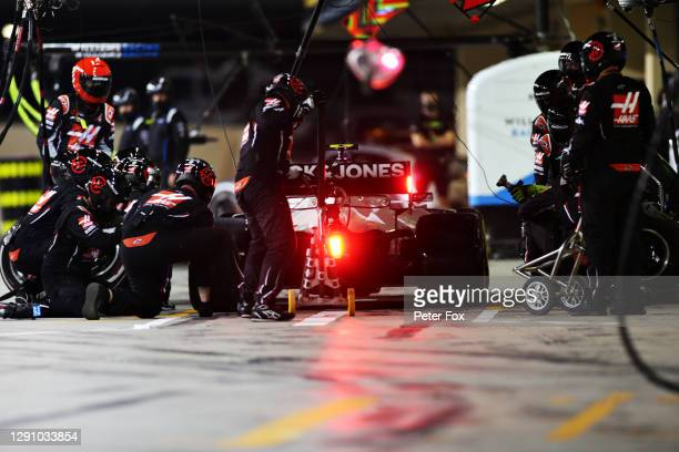 Kevin Magnussen of Denmark driving the Haas F1 Team VF-20 Ferrari makes a pitstop during the F1 Grand Prix of Abu Dhabi at Yas Marina Circuit on...