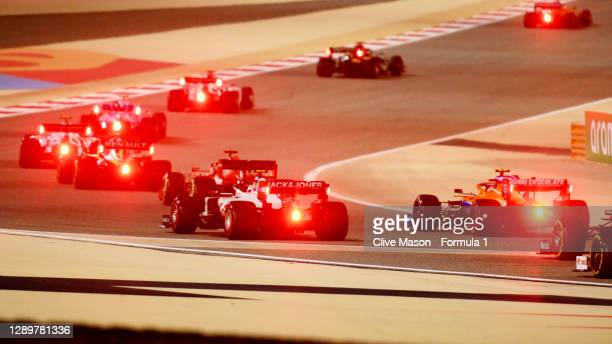 Kevin Magnussen of Denmark driving the Haas F1 Team VF-20 Ferrari and Lando Norris of Great Britain driving the McLaren F1 Team MCL35 Renault battle...