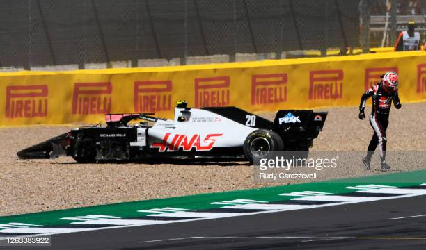 Kevin Magnussen of Denmark driving the Haas F1 Team VF-20 Ferrari leaves his car after spinning off during the F1 Grand Prix of Great Britain at...