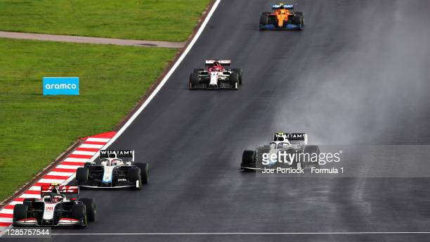 Kevin Magnussen of Denmark driving the Haas F1 Team VF20 Ferrari George Russell of Great Britain driving the Williams Racing FW43 Mercedes Nicholas...