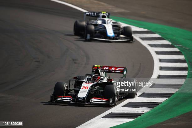 Kevin Magnussen of Denmark driving the Haas F1 Team VF-20 Ferrari leads Nicholas Latifi of Canada driving the Williams Racing FW43 Mercedes during...