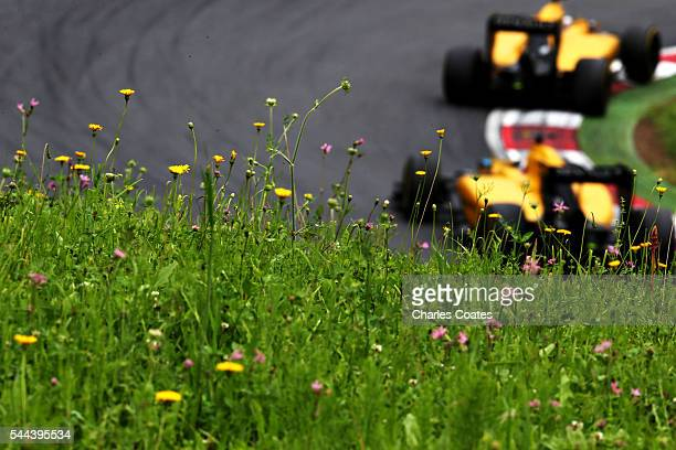 Kevin Magnussen of Denmark driving the Renault Sport Formula One Team Renault RS16 Renault RE16 turbo leads Jolyon Palmer of Great Britain driving...