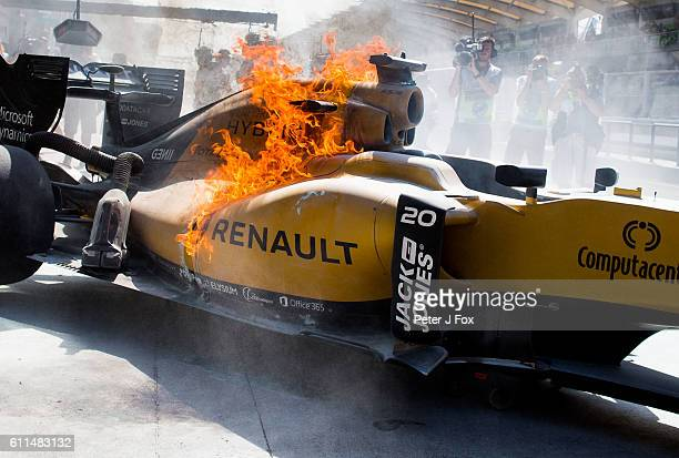Kevin Magnussen of Renault and Denmark catches fire during practice for the Malaysia Formula One Grand Prix at Sepang Circuit on September 30 2016 in...