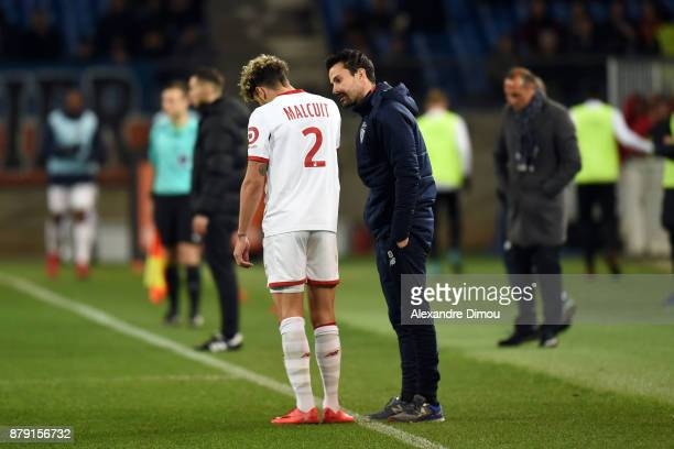 Kevin Malcuit and Joao Sacramento Coach of Lille during the Ligue 1 match between Montpellier Herault SC and Lille OSC at Stade de la Mosson on...