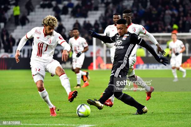 Kevin Malcuit of Lille and Memphis Depay of Lyon during the Ligue 1 match between Olympique Lyonnais and Lille OSC at Parc Olympique on November 29...