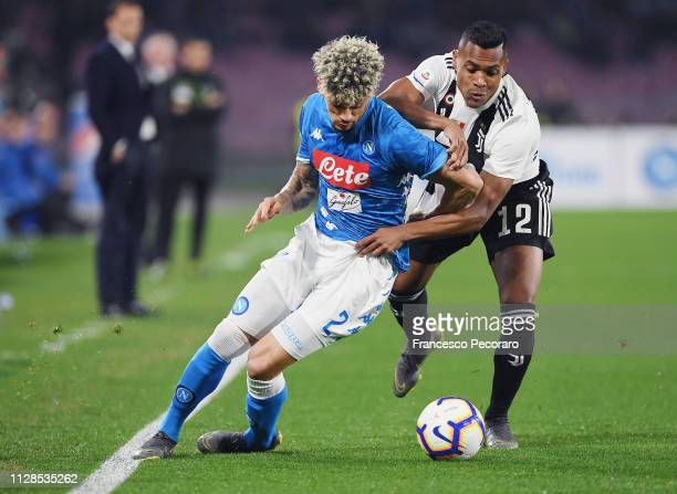 Kevin Malcuit of SSC Napoli vies Alex Sandro of Juventus during the Serie A match between SSC Napoli and Juventus at Stadio San Paolo on March 3 2019...