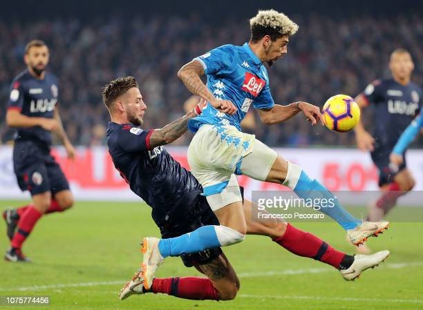 Kevin Malcuit of SSC Napoli vies Mitchell Dijks of Bologna FC during the Serie A match between SSC Napoli and Bologna FC at Stadio San Paolo on...